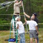 Attaching the beam to the mast. (L-R) Greg W1KM on ladder gets help from Don N1DG, Don AA1V & Micah N1QMM.